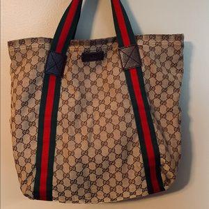 "Authentic Gucci ""Lifestyle"" classic logo tote."